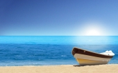 fond écran Barque en bord de mer